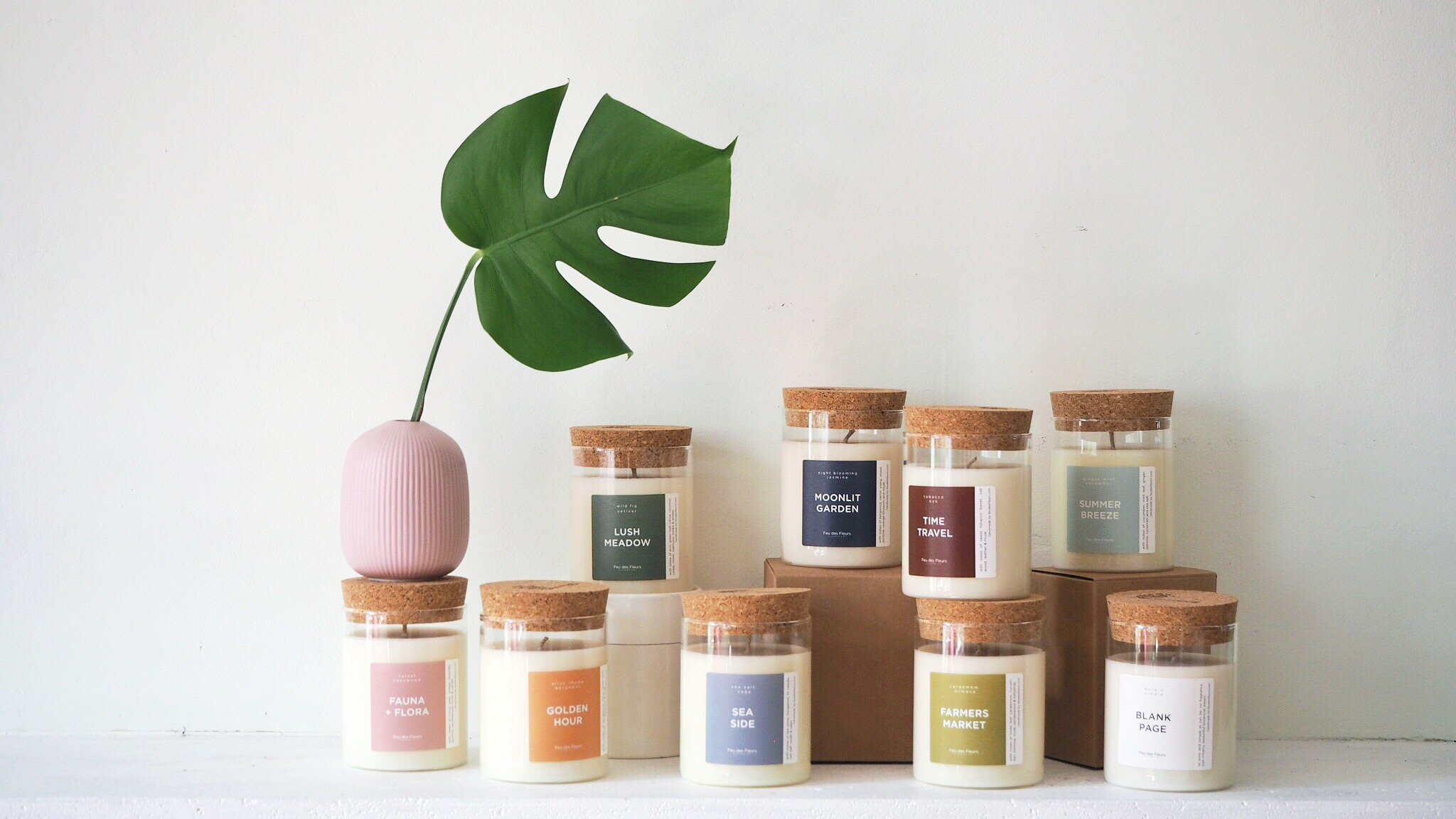 feu des fleurs scented candle collection in glass jars